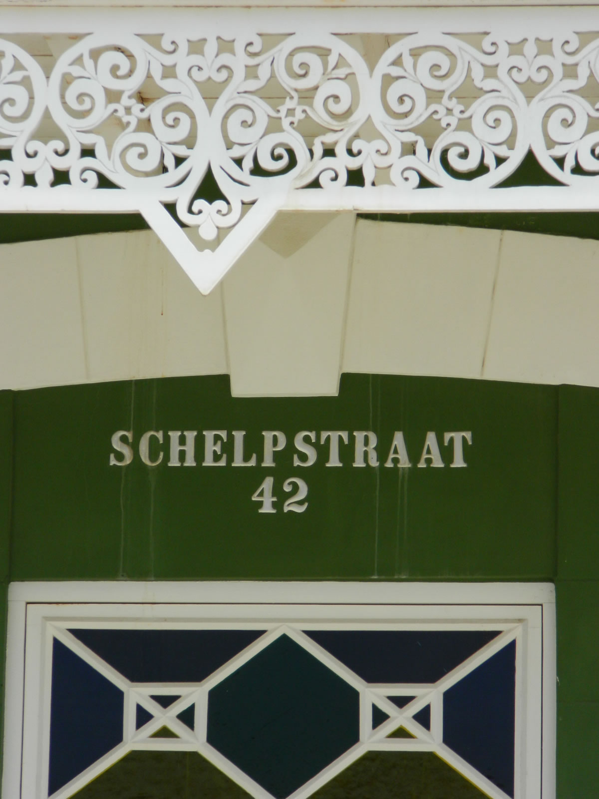 House number at Green 'Ecury' House | Archeological Museum Schelpstraat 42, Oranjestad